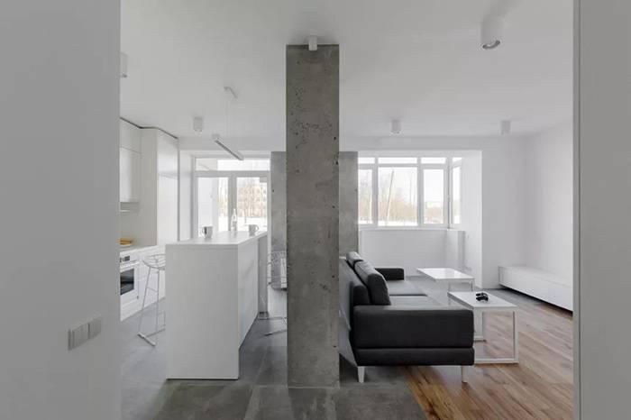 极简的白色与粗犷的水泥,碰撞出这个开放式设计的小家