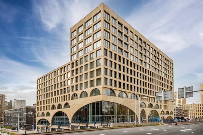 新兴住宅综合体设计,混凝土拱洞构筑共享空间